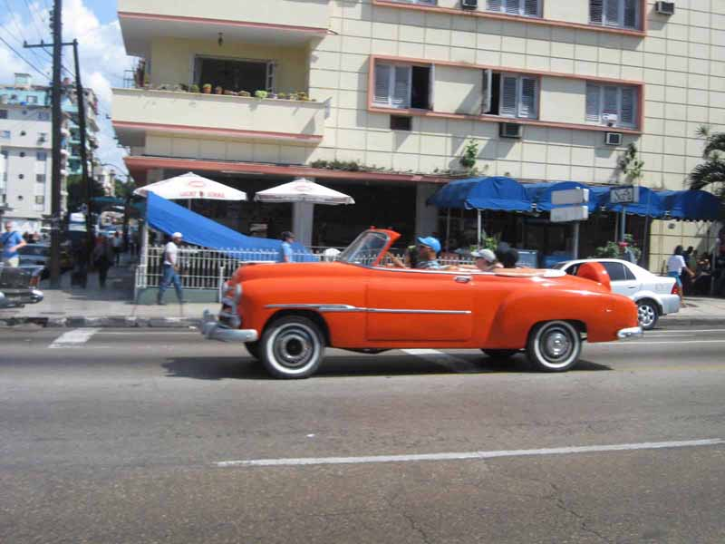 orange vintage car in havana