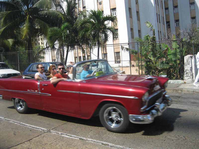 red wine vintage car in havana